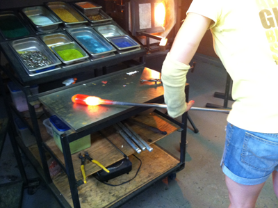 Our instructor, lengthening the glass prior to pumpkin shaping