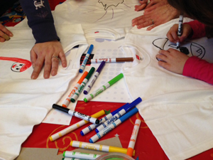 Kids working on t-shirts